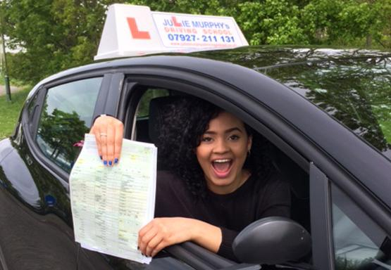 Driving school pupil after passing her test first time